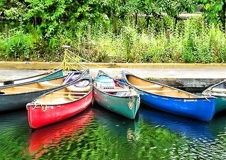 Image by Steven Iodice from Pixabay of canoes